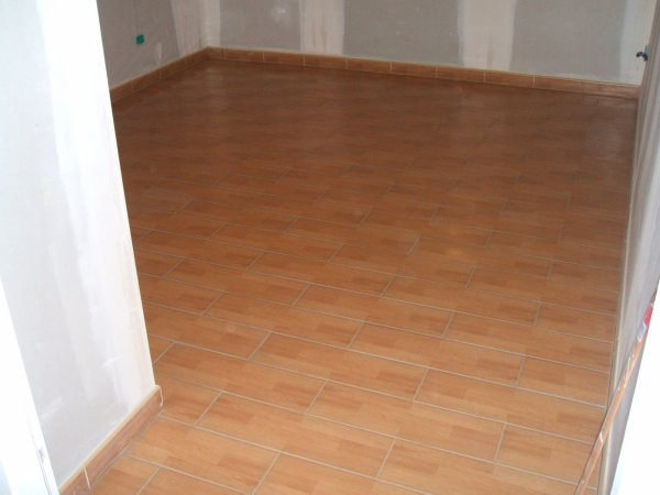 Carrelage imitation parquet 15 50 pas mal blog de thony amcm for Parquet stratifie imitation carrelage